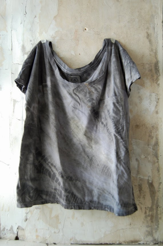 upcycled shirt on wall