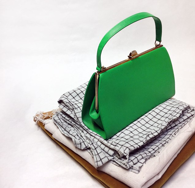 my-new-vintage-green-bag-on-fabric-pile