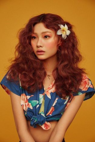 flowers in hair orange